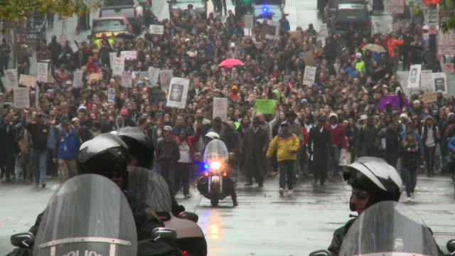 The NAACP organized a march in Seattle to protest the grand jury decision not to indict Officer Darren Wilson for the killing of Michael Brown in...