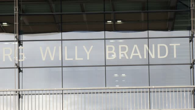 the name of the airport flughafen berlin brandenburg willy brandt is written on the facade at the entrance the main departures hall at the new ber... - flughafen stock videos & royalty-free footage