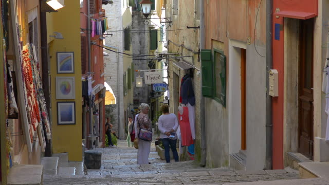 the narrow cobbled shopping streets. - narrow stock videos and b-roll footage