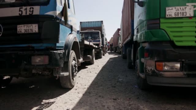 the national afghan trucking system provides a secure and reliable means of distributing reconstruction material, security equipment, fuel,... - security equipment stock videos & royalty-free footage