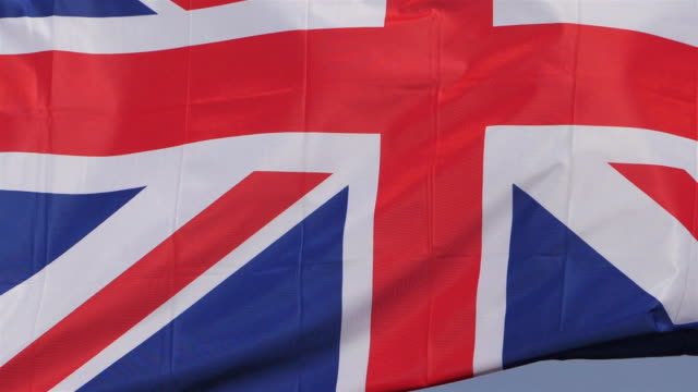 the national british flag waving in the wind. - union jack stock videos & royalty-free footage
