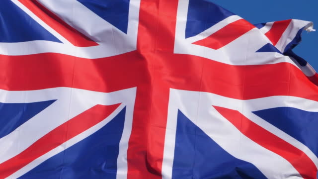 the national british flag waving in the wind. - british culture stock videos & royalty-free footage