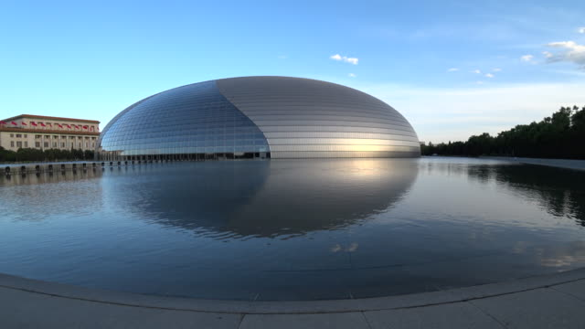the national centre for the performing arts, located beside the great hall of people, is the national theatre of china. - performing arts event stock videos & royalty-free footage