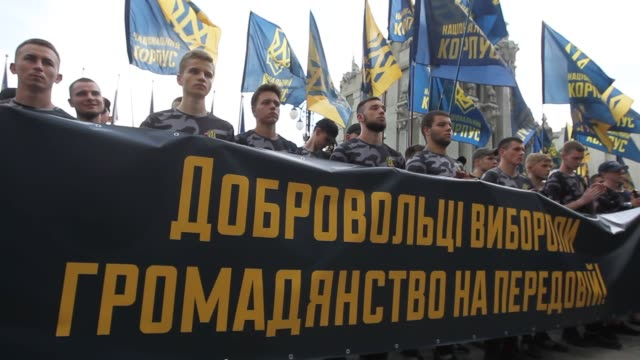 The National Corps activists and foreign volunteer fighters attend a rally in support of foreign citizens who joined Ukrainian armed forces and...