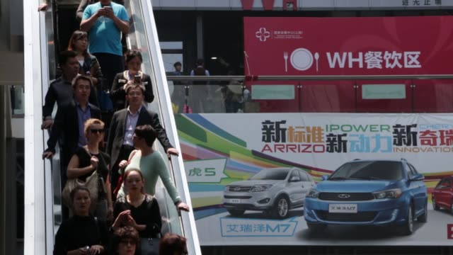 ws the national exhibition and convention center the venue for auto shanghai 2015 mws visitors ride on an escalator as they arrive ws visitors look... - smart automobile brand stock videos and b-roll footage