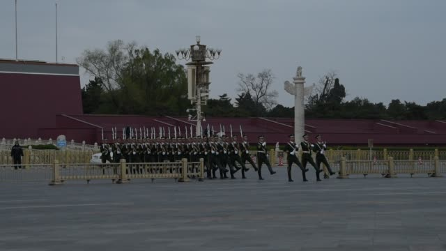 The National Flag Guards Walk In Tiananmen Square