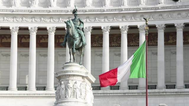 the national flag of italy flies in front of a monument to the unknown soldier in rome the italian national flag flies from a flagpole at castel... - italian flag stock videos and b-roll footage