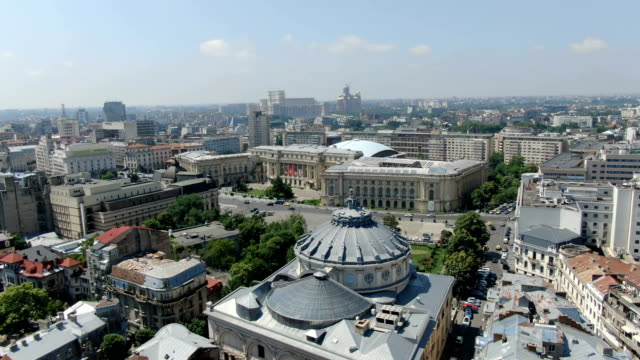 the national museum of art of romania and romanian athenaeum, bucharest / aerial drone view - romania video stock e b–roll