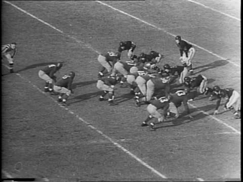 the national pro football title between the washington redskins vs the chicago bears / redskin, bob masterson kicks a field goal / redskin, andrew... - nfc east stock videos & royalty-free footage