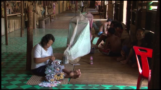 the native iban or dayak people of sarawak on the island of borneo live collectively in what are known as longhouses each family has its own living... - dayak stock videos and b-roll footage