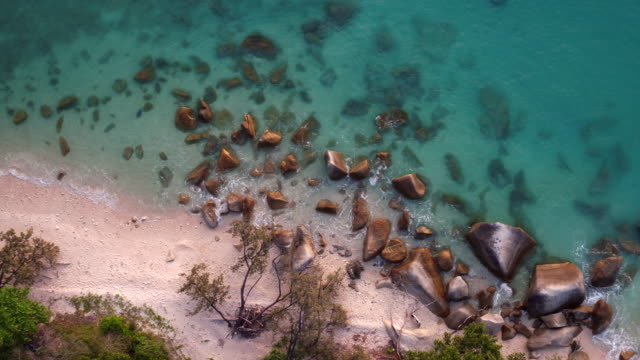 aerial: the nature of australia, the fitzroy island beach - water's edge stock videos & royalty-free footage