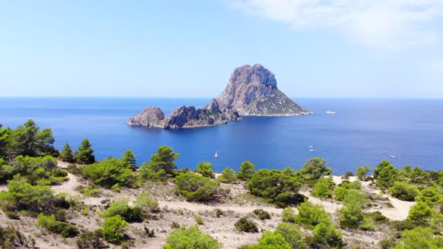the nature reserve of es vedra island in front ibiza coast taken with drone. el paisaje de ibiza con la isla de es vedra. - イビサ島点の映像素材/bロール