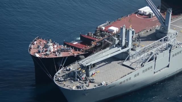 the navy's first mobile landing platform usns montford point demonstrates the capability to perform skintoskin operations vehicle transfer and to... - landing craft stock videos & royalty-free footage