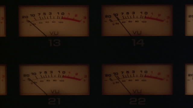 the needles on vu meters bounce back and forth. - pannello di controllo video stock e b–roll