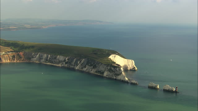 aerial the needles with military battery and alum bay / isle of wight, united kingdom - isle of wight stock videos & royalty-free footage