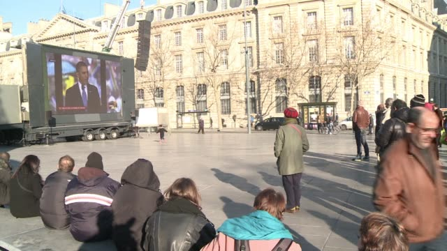 the nelson mandela memorial service in south africa is broadcast live on a big screen in central paris clean paris broadcasts mandela ceremony on... - live broadcast stock videos & royalty-free footage
