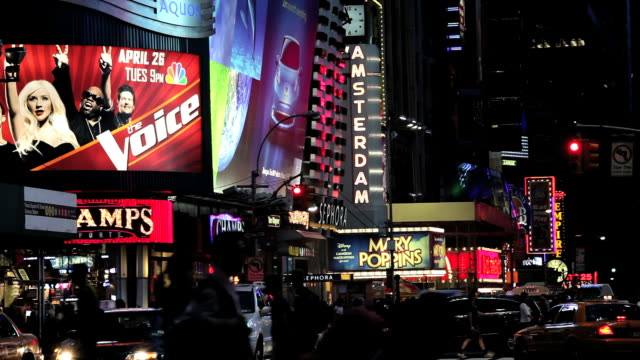 the neon lights of new york city and times square at night, manhattan, new york, north america, usa - ブロードウェイ点の映像素材/bロール
