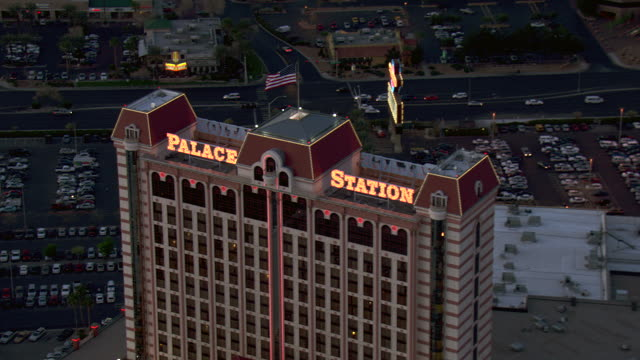 the neon sign of the palace station hotel and casino lights up the night sky. - casino sign stock videos & royalty-free footage