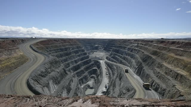 the neptune open pit mine stands at the st ives gold mine operated by gold fields ltd in kambalda australia on wednesday aug 9 dump trucks travels... - 鉱業点の映像素材/bロール