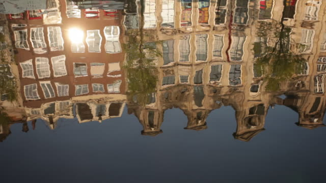 The Netherlands, Amsterdam, Reflections of canal houses in canal called Brouwersgracht. Unesco World Heritage site.