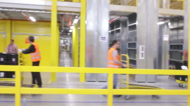The new Amazon Inc fulfilment center on its official day of opening in Bielany Wroclawskie Poland on Tuesday Oct 28 employees scan products to be...