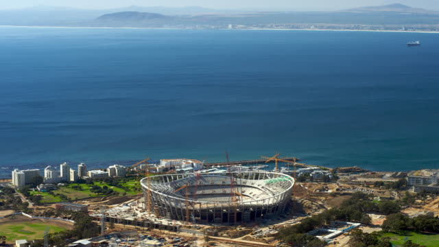 t/l the new fifa 2010 cape town stadium under construction in greenpoint, seen from signal hill, south africa - fifa stock videos & royalty-free footage