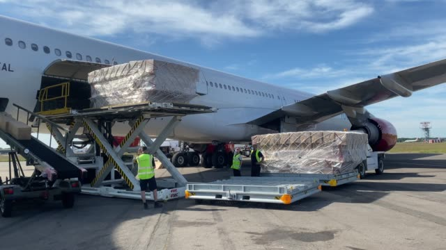 the new livery design is seen on a plane due to leave for china today on may 21, 2020 in bournemouth, england. the airbus a340, owned by european... - freight transportation stock videos & royalty-free footage