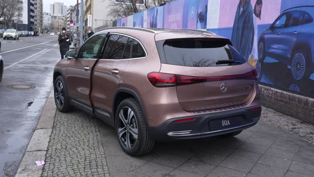 the new mercedes-benz eqa electric suv stands next to a billboard advertising its debut during a short photoshoot prior to the car's live-streamed... - electricity stock videos & royalty-free footage