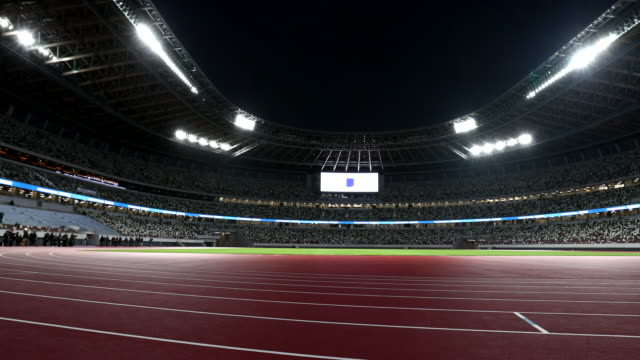 the new national stadium is seen during a media tour following by the construction completion ceremony on december 15 tokyo, japan. members of the... - stabilimento sportivo video stock e b–roll