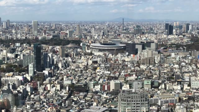the new national stadium the main stadium for the tokyo 2020 olympics is pictured on march 24 2020 in tokyo japan although an official decision is... - tokyo japan stock videos & royalty-free footage