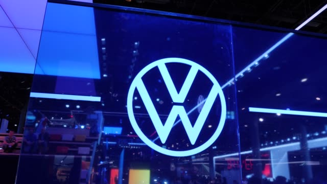 the new volkswagen logo is seen on a lit plexiglass shield at the 2019 iaa frankfurt auto show on september 10 2019 in frankfurt am main germany the... - logo stock-videos und b-roll-filmmaterial