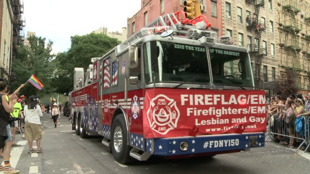 the new york city fire department and the new york city police department both show their support by participating in the parade / a firetruck makes... - fire department of the city of new york stock-videos und b-roll-filmmaterial