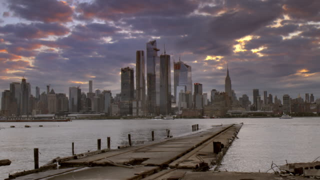 the new york city skyline at dawn.  the hudson yards are under construction. - abandoned stock videos & royalty-free footage