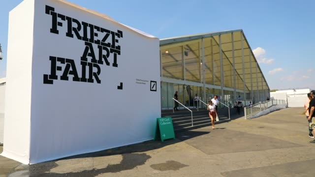 the new york frieze art fair on on may 3 2018 in new york city held on randalls island a short water taxi car or bus ride from manhattan the fourday... - fries säulengebälk stock-videos und b-roll-filmmaterial