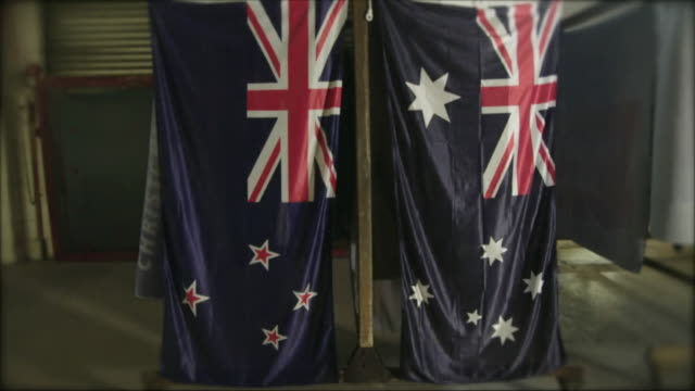 The New Zealand and Australian flags hang side by side