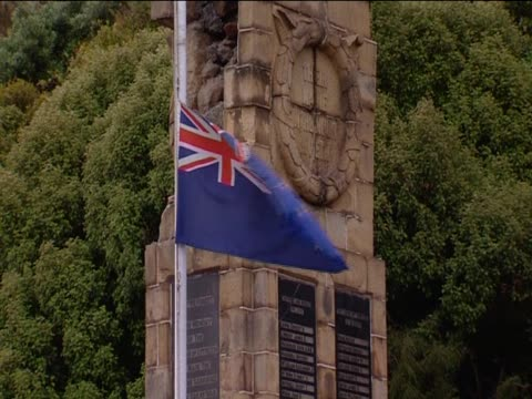 The New Zealand flag flies at a war memorial damaged by the Christchurch earthquake