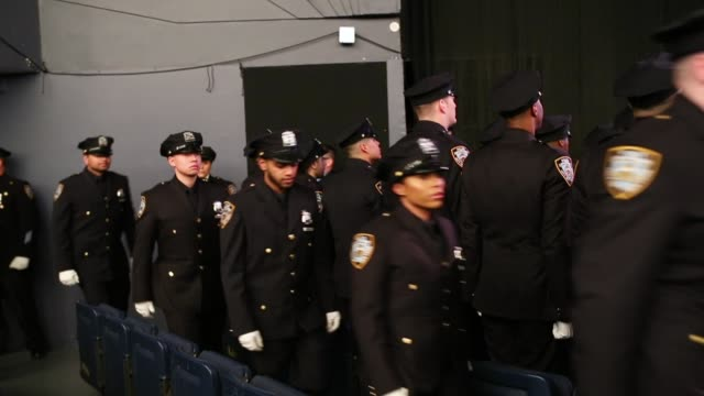the newest members of the new york city police department attend their police academy graduation ceremony at the theater at madison square garden... - officer military rank stock videos & royalty-free footage