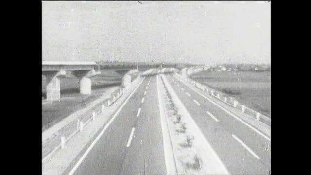 vidéos et rushes de the newly completed meishin expressway stretch through rural postwar era japan. - après guerre