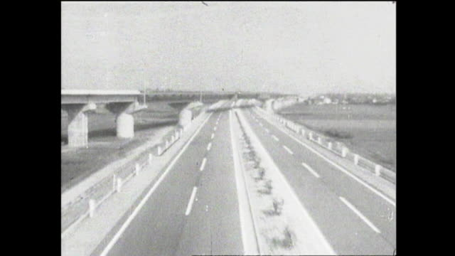The newly completed Meishin Expressway stretch through rural Postwar Era Japan.