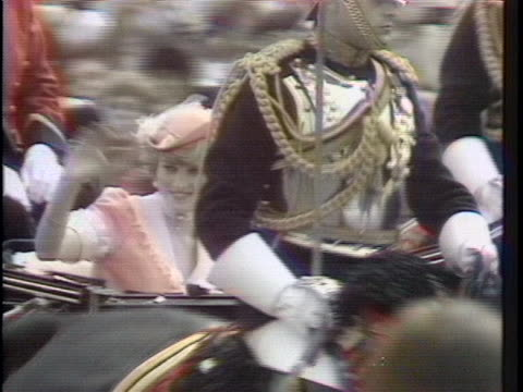 the newly-wed prince charles and lady diana are seen in an open carriage riding through the gates of buckingham palace en route to their honeymoon.... - fairytale stock videos & royalty-free footage