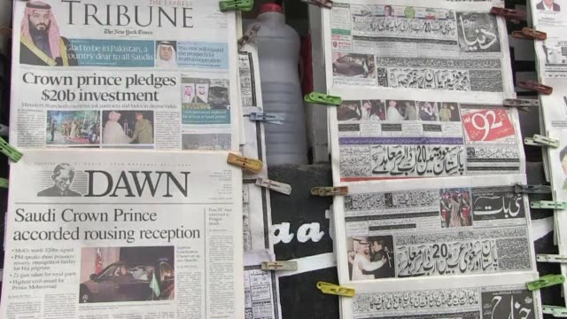 the news on saudi arabia and pakistan signing investment deals worth up to $20 billion for the cash strapped south asian country dominates the... - newspaper headline stock videos & royalty-free footage
