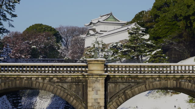 the next morning of winter snowstorm at chiyoda-ku tokyo japan – january. 23 2018. niju-bashi bridge and fushimi yagura at edo castle, which are covered by snow in the imperial palace. - moat stock videos and b-roll footage