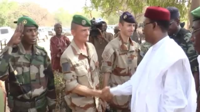 the nigerien president mahamadou issoufou has visited the town of diffa in southeast niger to meet with foreign troops deployed there - mahamadou issoufou stock videos and b-roll footage