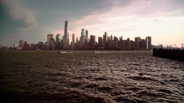 the night panoramic view of the illuminated manhattan, new york city, over the hudson river from the liberty state park, jersey city, new jersey - hudson river stock videos & royalty-free footage