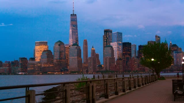 The night panoramic view of the illuminated Manhattan, New York City, over the Hudson River from the Liberty State Park, Jersey City, New Jersey