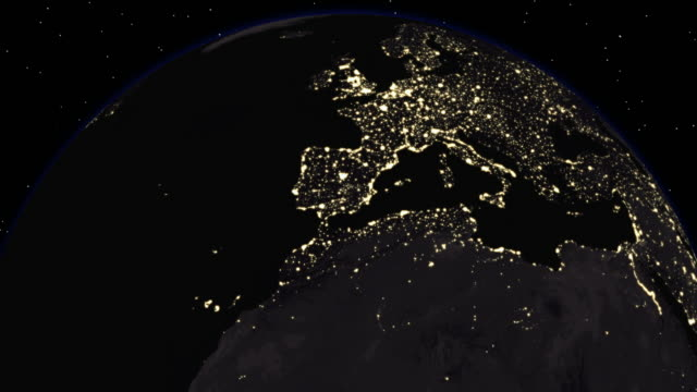 The night side of the Earth with city lights visible (Loop).