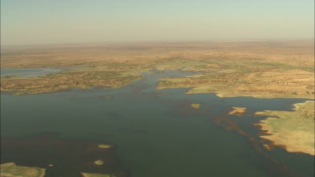 the nile river borders a vast desert that stretches to the horizon. - dry stock videos & royalty-free footage