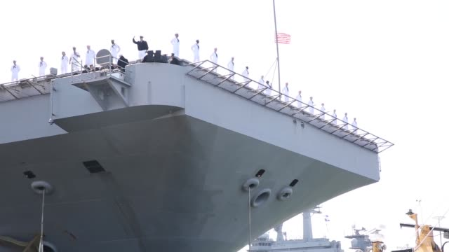 The Nimitz class aircraft carrier USS Harry S Truman departs Naval Station Norfolk on 11 April 2018 on a regularly scheduled deployment with strike...