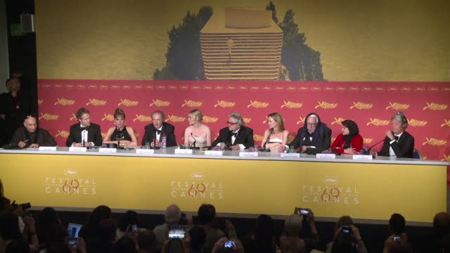 The nine member Cannes jury chaired by Mad Max director George Miller awarded the Palme d'Or top prize at Cannes Sunday to British director Ken Loach...