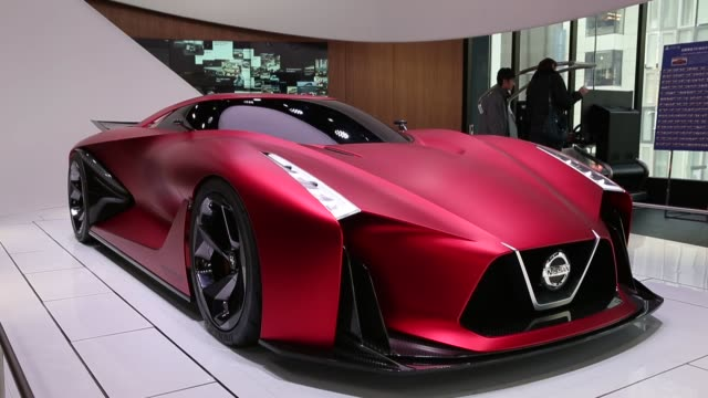 The Nissan Concept 2020 Vision Gran Turismo concept vehicle sits displayed at Nissan Motor Co's Nissan Crossing showroom in the Ginza district of...